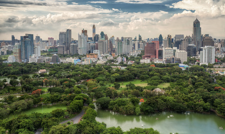 bangrak: Lumpinee garden and Sathorn building in Bangkok, Thailand Stock Photo