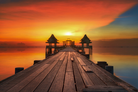 chonburi: Sunset and reflection with wooded bridge in the temple