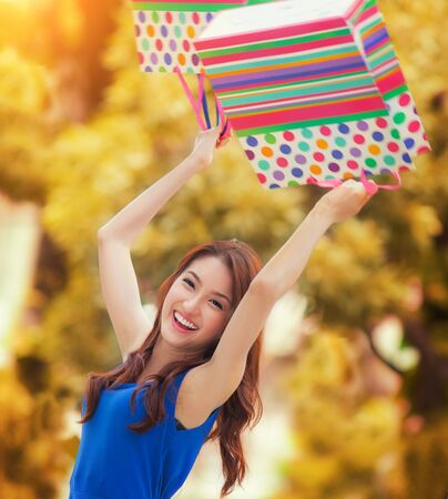 honking: Asian lady enjoy shopping with shopping bag Stock Photo