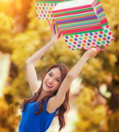 honking: Asian lady enjoy shopping with shopping bag Stock Photo
