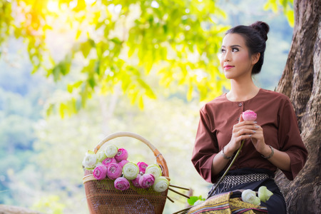 Asia women and lotus flower, water lilly in vintage and country life style Stok Fotoğraf