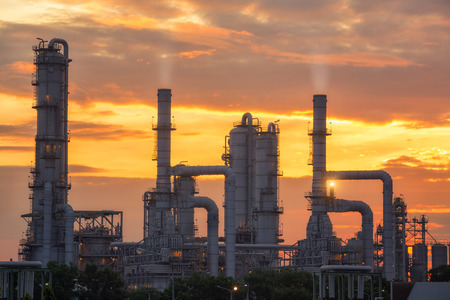 chemical plant and oil refinery industry with sunrise. Pipe line and oil tank