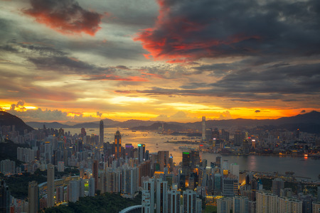 Cityscape of Hong kong and Kowloon with harbour and sunset, big city in China