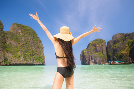 aonang: Portrait of woman in black swim posing on tropical beach,  maya beach, Phi Phi island near Phuket in Thailand
