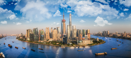 Shanghai city with river front and transprtation boat and blue sky, shanng hai, china, asia