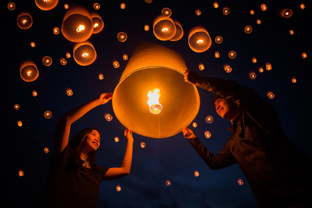 yeepeng: sweetheart and valentine, Family, Thai people floating lamp in Yeepeng festival Stock Photo