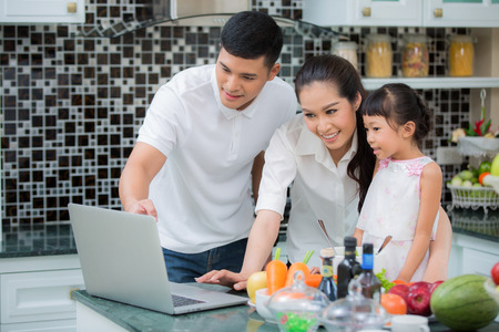 Asian Family Kitchen Lifestyle, father, mother and Daughter cooking food my use manu in internet,