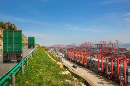 Truck transport container on the road to the port. import, export and logistic concept in Shanghai