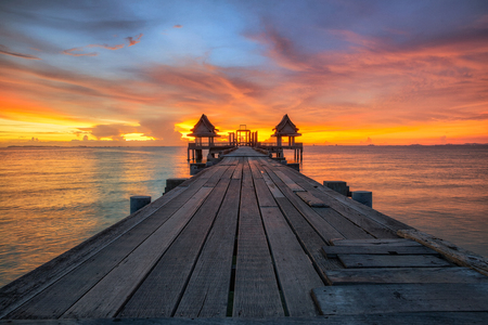puget: Landscape of Temple and Wooded bridge in the port and sunrise, Pattaya city, Thailand