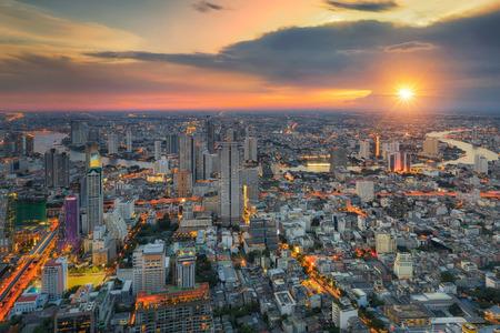 Bangkok city at sunset, Mahanakorn tower, Silom area, Thailand Stock Photo