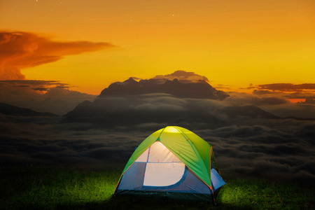 morning night: Morning sunrise over mist with Huai Nam Dang National Park, Chiang Mai, Thailand, landscape, travel and nature , Small Camping Tent Illuminated Inside. Night Hours Campsite. Outdoor