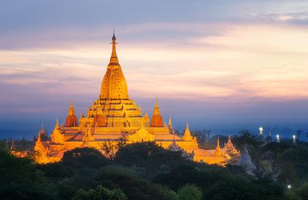Pagoda landscape under a warm sunset in the plain of Bagan, Myanmar (Burma) Editorial