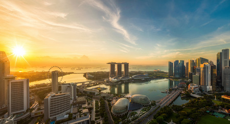 Landscape of Singapore city in morning light sunrise with business center, harbor view, Marina bay sand and Garden by the bay park, Standard-Bild