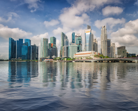 Singapore business center skyline and blusky in day time with reflection on water, Singapore city