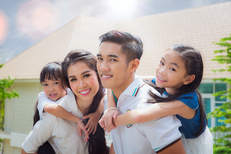 Asian family stand togather with famther, mother and Daughter on home terace, Asia family and out door concept