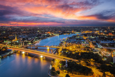 Bangkok river with sunset time from roof top of high building, Wat arun, Pho temple, rama one bridge and thonburi city in this view. Stock Photo