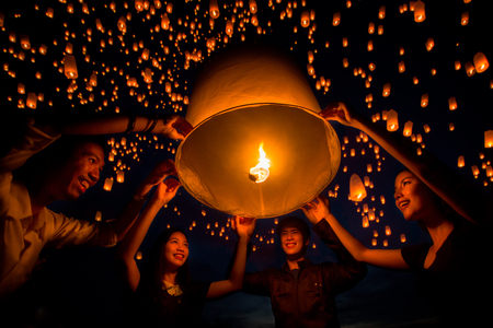 friend group enjoy yeepeng festival togather in Thailand, Yee peng is balloon and fire and very faver to play in asia such as Thailand, China and Taiwan