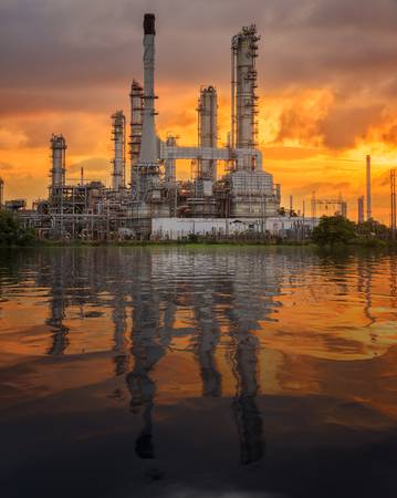 Oil tank and oil refinery factory in Thailand with smoke and frame from refinery process, industrial, power, energy and environment concept