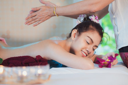 Asian lady relax in skin care aroma therapy and  scrub spa, in Thailand resort