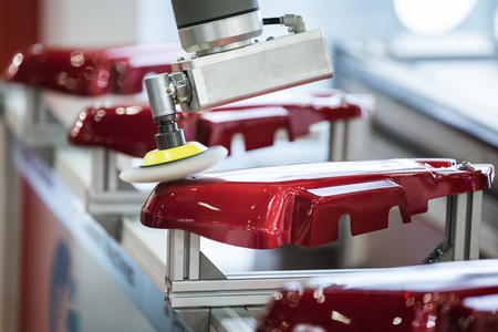 Automatic color polishing machine in auto part making line, production, factory, qc, automation, system and safety concept