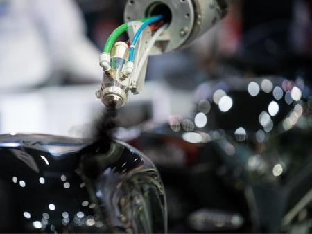 自動車とロボットと PLC による制御のペイント ボディ部の自動空気塗装ライン 写真素材