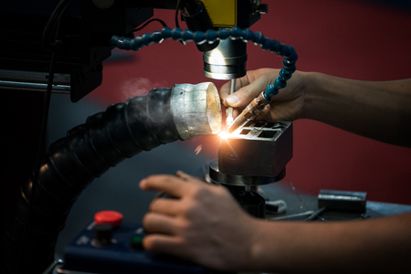 Closeup of laser welding process for repair mold and die
