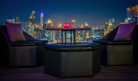 Relax coner in roof top bar and restaurant with bangkok night backgrounf, bangkok, Thailand