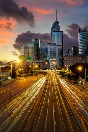 Landscape of Hong kong city on night, Super high way and building with light of car and sunrise in Hongkong city, Hong kong morning and transportation, China