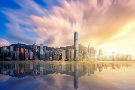 Hong kong city before sunset with Victoria peak, Hongkong Harbour and reflection, Hong kong, China