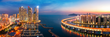 Sunset in Busan city with building, bridge and harbor, Korea, Asia Stockfoto - 105097841