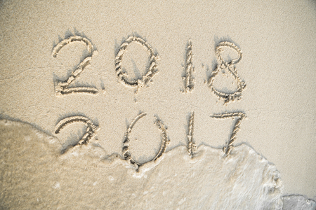 idea for 2017 end of year and 2018 happy new year from sand and wave Stock Photo