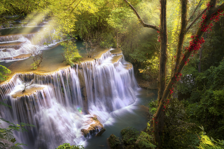 Huai Mae Khamin waterfall the layer of stone, sunrise and green forest in Kanchannaburi, Thailand, Asia