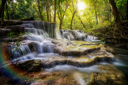 Huai Mae Khamin waterfall the layer of stone, moss and green forest in Kanchannaburi, Thailand, Asia