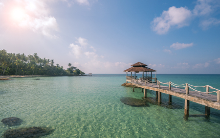 Wooded bridge to pavilion at Koh Kood island with white sand beauty beach and kayak boat. This immage can use for Thailand, travel, relax, asia, summer, and holiday concept Stock Photo