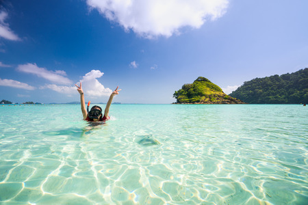 Asian girl swimming in Kam beach between Koh Kood and Koh Mak in Thailand sea, Island in Thailand and Asia, This immage can use for Summer, Holiday and travel concept Stock Photo