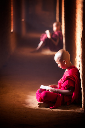 Monk study in temple by read a book, bagan temple in Myanmar