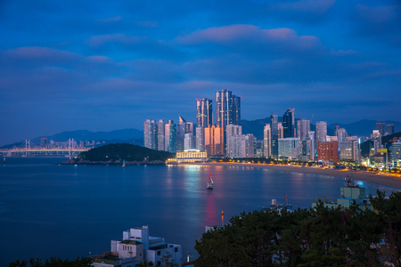 Busan haeundae beach and bridge at night time near morning sunrise, Busan city, South Korea