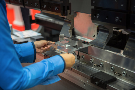 Worker working in factory in metal sheet bending process, this immage can use for factory, industrial, production and job concept 스톡 콘텐츠