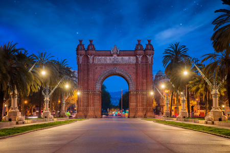 Bacelona Arc de Triomf at night in the city of Barcelona in Catalonia, Spain. The arch is built in reddish brickwork in the Neo Mudejar style