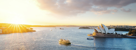 Cityscape of Sysney harbour with morning sunrise moment and boat in the sea, New south wales, Australia, this immage can use for travel, trorist and Sysney concept Stock Photo
