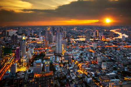 Cityscape view from roof top of tower in Bangkokcity with building, river and sunset, Bangkok city, Thailand, Asia Imagens