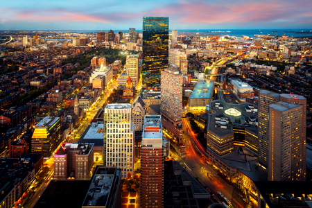 An aerial night view of Boston city center with sunset skyline, Massachusetts