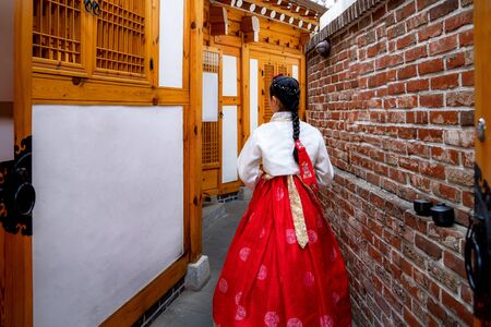 Korean lady in Hanbok or Korea dress and walk in an ancient town and Gyeongbokgung Palace in seoul, Seoul city, South Korea. Stock Photo