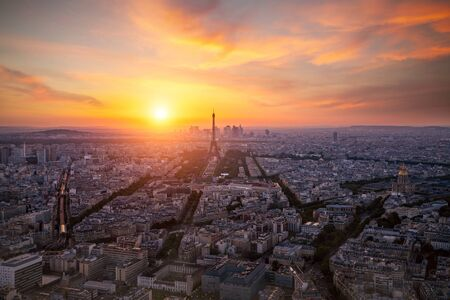 Aerial view, from Montparnasse tower at sunset and night sky, view of the Eiffel Tower and La Defense district in Paris, France Stock fotó