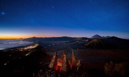 Star and Bromo mountain between night and sunrise time at Seruni view point, Java island, Indonesia
