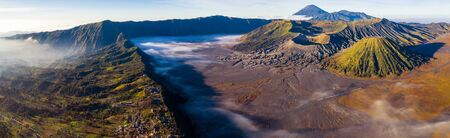 landscape of mountain to take a sunrise photo by drone for Bromo volcano, Landscape of Bromo volcano from view point on top of mountain, Java island, Indonesia this image can use for travel, outdoor, nature