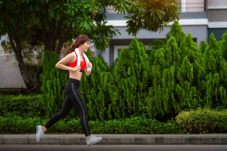Asian girl running in her village with sportswear this image can use for sport and health concept Reklamní fotografie