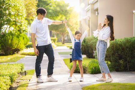 Asian family play and exercise togather in the park in they village, this image can use for father, mother, home and house concept Stock Photo