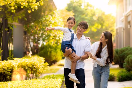 Asian family walking together in the village gardent, this image can use for father, mother , daughter, park, outdoor and home concept. Stock fotó