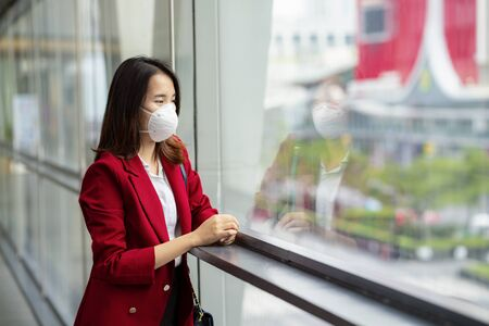Asian girl use a protection mask for prevent PM 2.5 and corona